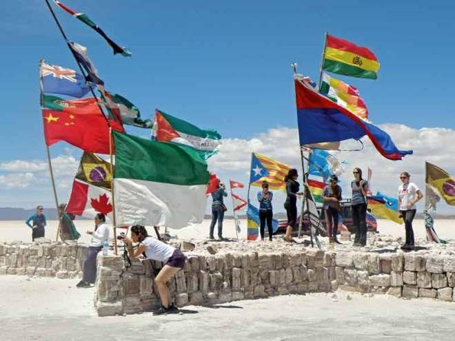 Flags from across the globe flutter on a platform of salt bricks.