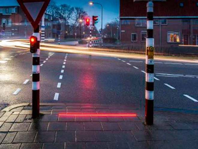 """Pavement lights for smartphone addicts Bodegraven, a Dutch town is trialling a traffic light system specially aimed at smartphone addicts. A series of LED lights in red and green, embedded into the pavement at pedestrian crossings, alert pedestrians addicted to their smartphones either on social media or mobile gaming, on when to cross the road and when to stop, depending upon the traffic signal. Though it serves to reduce traffic accidents, the system, called +Lichtlijn, has attracted criticism from a Dutch road safety organisation claiming it """"rewards bad behaviour."""" If this pilot proves successful, more will be rolled out across Netherlands. Similar pavement lights are being tested in the German city of Augsburg too."""