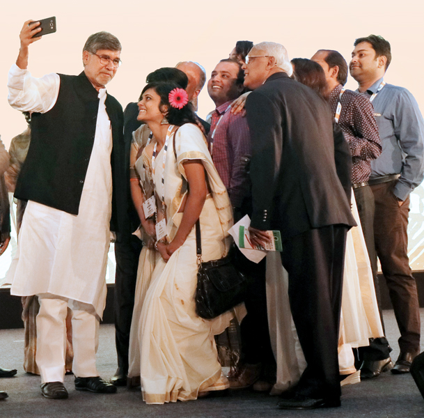 Nobel Peace Laureate Kailash Satyarthi takes a selfie with RILM staff and RILM Secretary Aniruddha Roy Chowdhury.