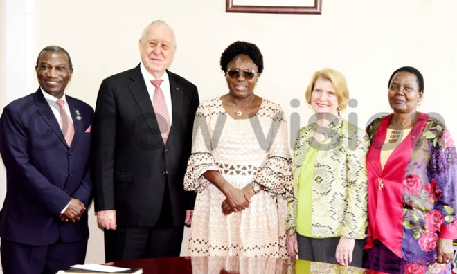 Rotary International president John Germ (2nd L) and wife Judy Germ (2nd R), incoming president Sam Owori (L) and his wife (R) pose for a picture with Speaker of Ugandan Parliament Rebecca Kadaga.