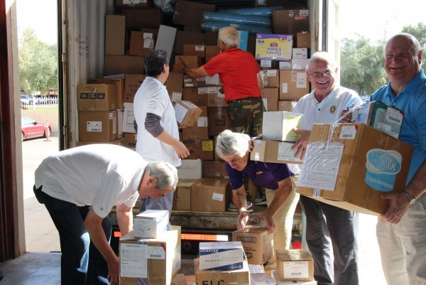 Rotarians from the Scottsdale Sunrise Rotary Club help load up a shipping container with medical supplies headed for Rwanda, Africa.