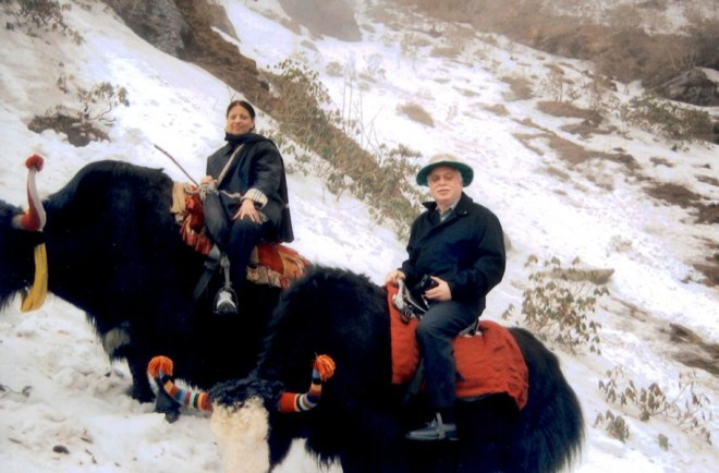 Riding yaks at Tsomgo Lake, Sikkim, in the Himalayas.