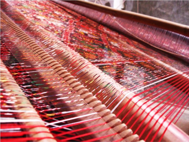 Ikkat yarn on the loom.
