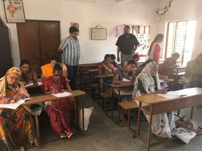 Adult learners write the NIOS exam at Bharuch.