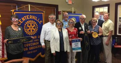Members of the Rotary Club of Centerville show off their Rotary sunglasses and awards from the District 6920 meeting.