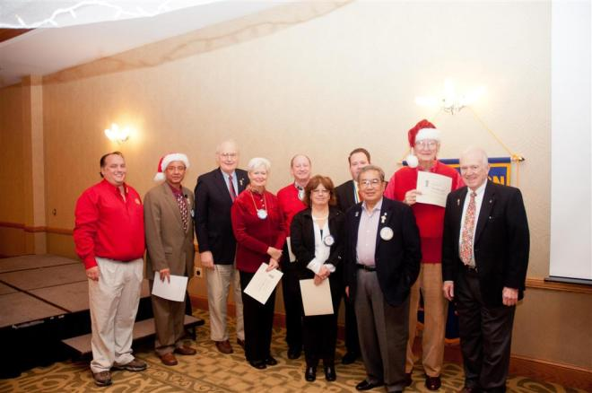 Six members of the Champaign  Rotary Club were enrolled as new members of the Paul Harris Society during the club's weekly meeting.