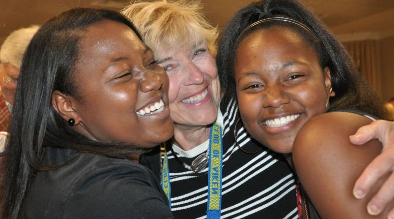 Twin sisters Q'Ladrin Qouters (left) and Q'May Qouters share a hug with Betty Ryberg during the Rotary Club of Aiken meeting at Newberry Hall. Each of the siblings received a $5,000 scholarship from the Rotary club. Ryberg is the chair of the Rotary Club's Scholarship Committee. Photo: Dede Biles