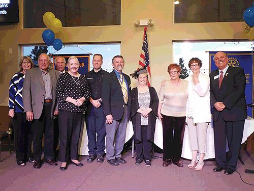 (L to R) County Supervisor Janice Rutherford, Rotary Award winners Peter Venturini, Gregg Rice, Jeannie Venturini, Anthony Muscarello, Bill Mellinger, Marci Collar, Shelli Arons, Jennifer Tilden, and Crestline-Lake Gregory Rotary Club President Derek Leistra. (Photo: Rhea-Frances Tetley)