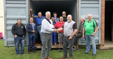 COMMUNITY KINDNESS: Rotary Club of Lismore president Neil Woods (on left) presented Lismore Men's & Community Shed president George Sparnon with a 20ft shipping container and a $1000 voucher for Summerland Tools.