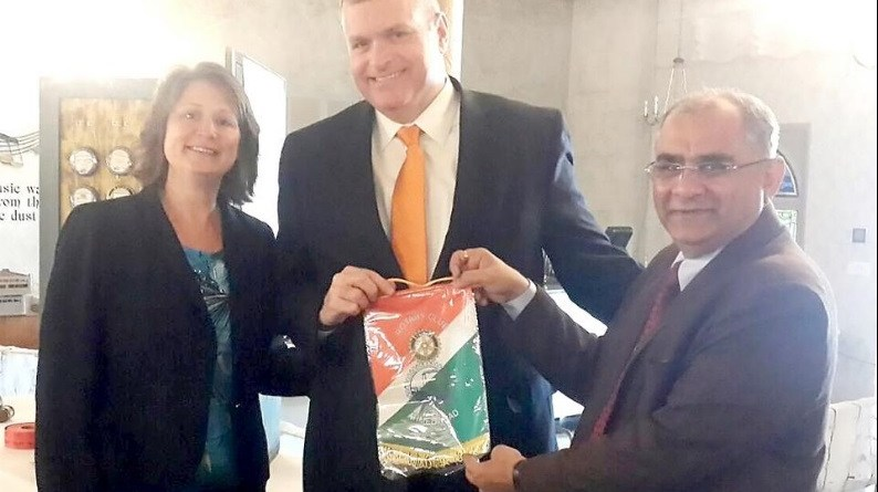 Sanjay Mehta from Ahmedabad presented an International Rotary India flag to Duke Anderson, Rotary president. They are seen with Rachel Doty, president elect.