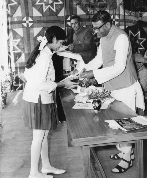 Receiving an award as State topper in 1973