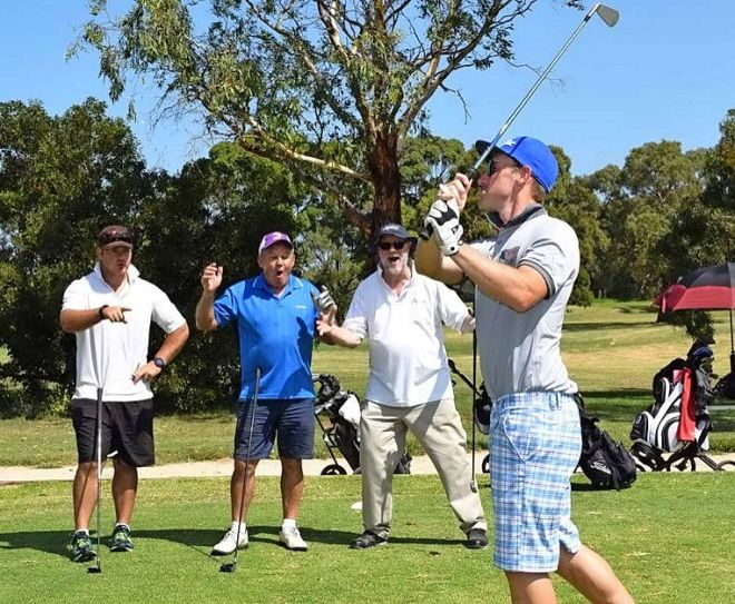 Golfers in action at the club's fundraiser.