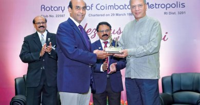 RC Coimbatore Metropolis President Jayakumar Ramdass presenting a memento to PRIP K R Ravindran. Also present are D 3201 DG Prakash Chandran and PDG V Rajkumar (left).