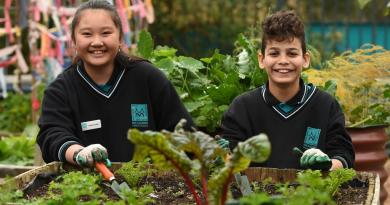 Meadows students Han and Abdul get digging in their school garden. Picture: David Smith