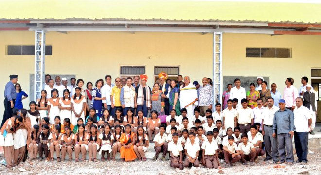 AKS member Suresh Poddar, Kiran Poddar, PDG Anil Agarwal, Pankaj Patel with students at the Babasaheb Ambedkar Vidyalaya.