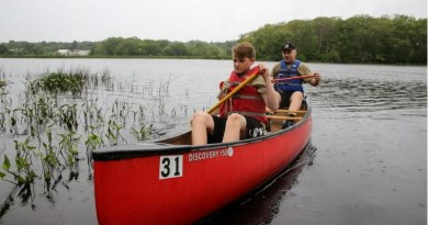 Joey Leclaire (right) and Matt LaCrosse paddle a canoe during the Milford Rotary Outdoor Day at Milford Pond. Photo: Dan Holmes