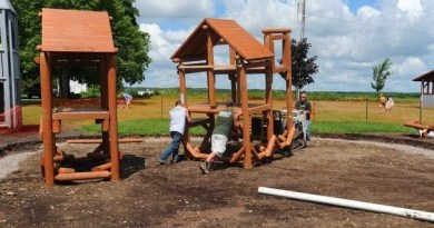 Workers from Bears Playgrounds work to assemble the village park's new equipment in Perry, thank to the local Rotary club. Photo: Rocco Laurienzo