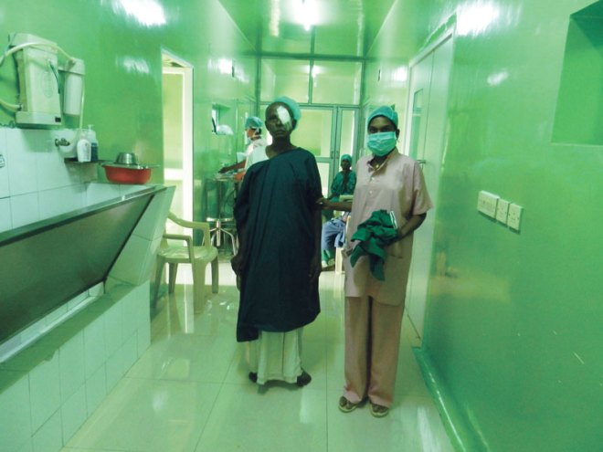 A patient being led to his bed after the surgery.