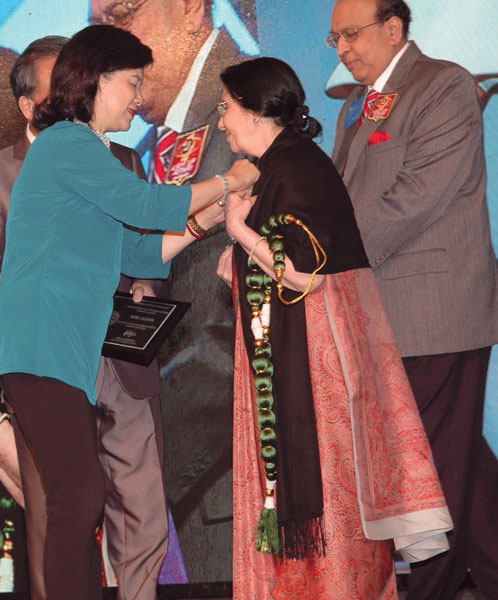 "Award time: Usha Saboo being conferred Rotary Spouse award for ""demonstrating exemplary humanitarian service through Rotary."""