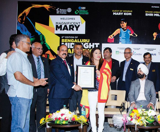 RC IT Corridor, RI District 3190 felicitated Olympian Boxer Mary Kom for winning Gold in the Asian Games. She was honoured by DG ­Manjunath Shetty and club President Rajiv Unni at the curtain raiser for the 'Mid Night Marathon' to be held on December 21, 2014 at Bangalore.