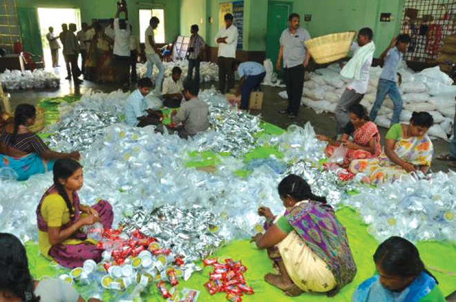 Workers assembling food kits.