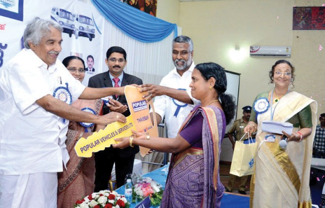 Chief Minister of Kerala, Ommen Chandy presenting the keys.