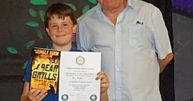 Max Green of Ab Kettleby Primary School with his award from Rotarian Tony Pick.