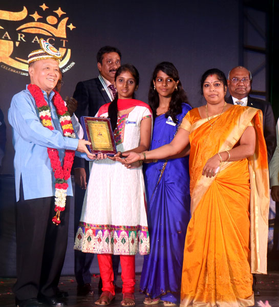 PRIP Gary Huang presents an award to Rotaractors in the presence of RID C Basker (extreme right) and DG R Srinivasan (centre).