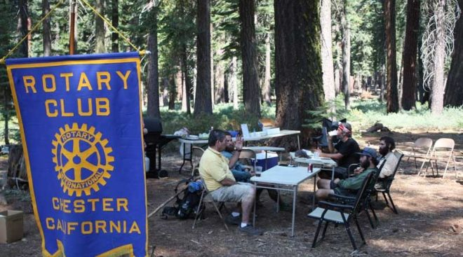 The Pacific Crest Trail hikers are ready to just sit and relax while Chester Rotary's Trail Café is being set up. They come from different places including Australia, West Virginia, Minnesota and California and intermingle at the cafe point. Rotary member Terry Johnson (left) chats and finds out what they would like to eat. Photo: Gregg Scott