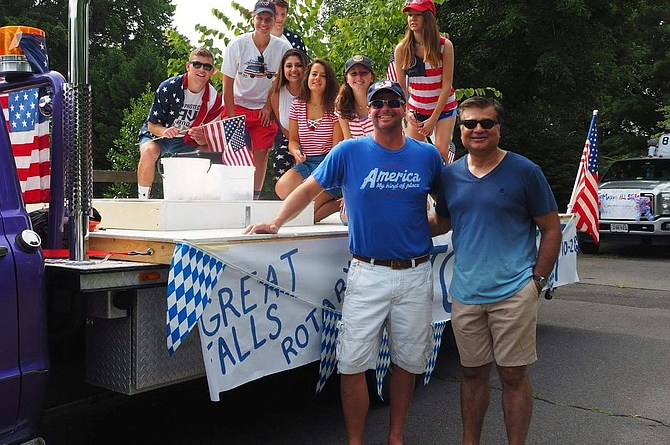 The President of Great Falls Rotary Vishal Chawla and its Vice President Butch Sevila pictured with the Club's float at the Fourth of July celebration in Great Falls. Photo: Submitted