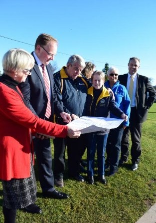 Members of Rotary Club of Ulverstone along with local body officials look at the construction plans for a storage facility. Photo: Sarah Landsdown.
