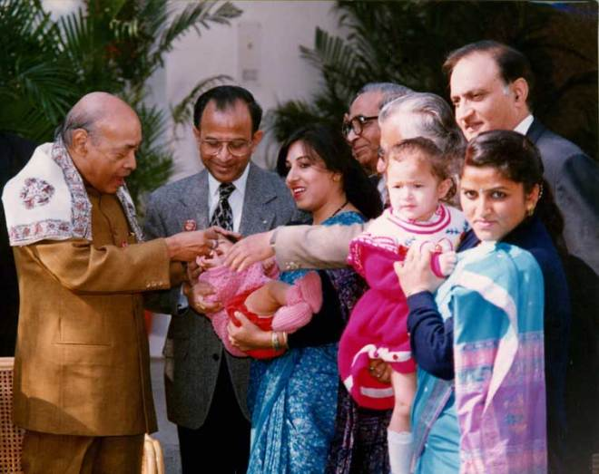 Prime Minister P V Narasimha Rao administers polio drop to a child in the 1995 NID in the presence of PRIP Rajendra Saboo, (second from left), then INPPC Chair O P Vaish (fourth from left) and former RISAO Regional Head Vinod Bhola (right).