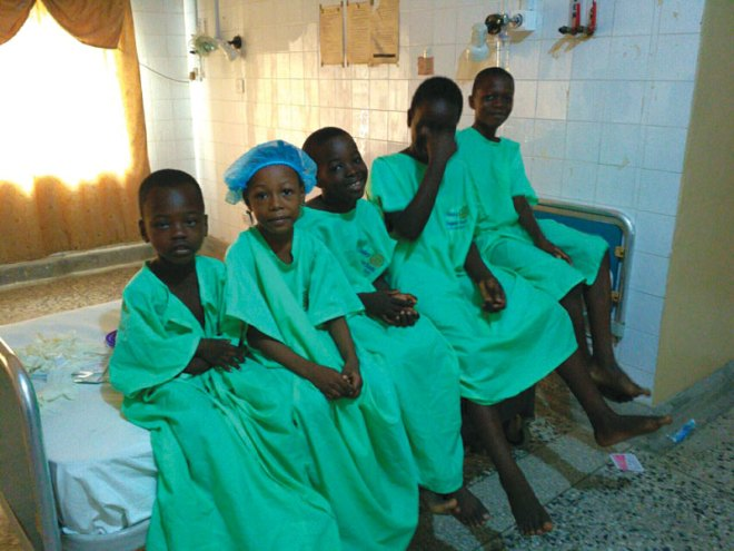 Above: Children awaiting treatment in the hospital.