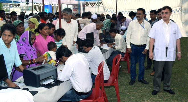 PDG Vivek Tankha overseeing the registrations at the RAHAT camp.