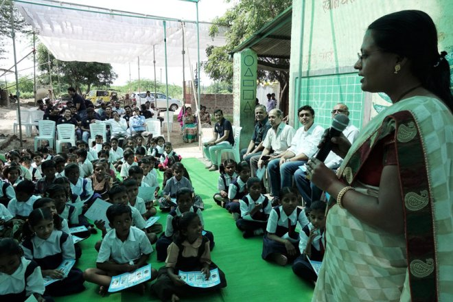 Kiran Authi, Principal, Krishna Nagar Z P School, teaching the students on how to use the Shudhu tablets.