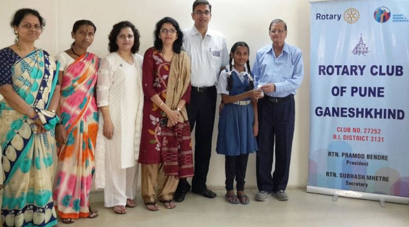 Dr Ramesh Godbole provides medicines to Sapna Kasbe in the presence of (from R) Club President ­Pramod ­Bendre, Varsha, Alka Pawar, Sapna's mother and teacher Lalita Naravane.