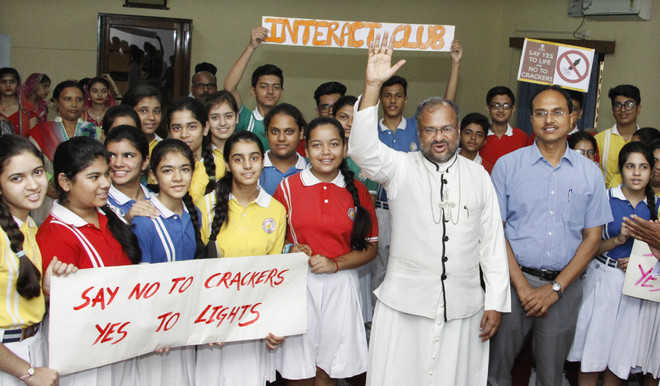 School students, along with Bishop Dr Franco Mulakkal and DC Varinder Kumar Sharma, during an event at Bishop House in Jalandhar. Photo: Sarabjit Singh