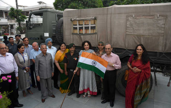 MP Kirron Kher, along with PRIP Rajendra K Saboo and other officials of the Rotary Club of Chandigarh, flags off a truckload of sweets for soliders on Thursday. Photo: Nitin Mittal