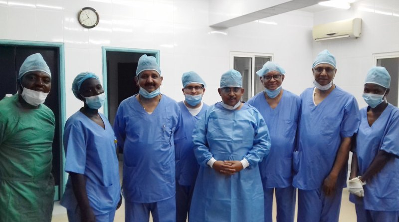 From R: Dr K V Ravishankar, Dr M V Ravikumar, Dr Arnab Biswas, Abhijit Ramprasad and Dr Vasantha Kumar with Anaesthesia Assistant Mbisin and Ophthalmologist Dr Oke of Sheik Zayed hospital in Banjul, the Gambia.