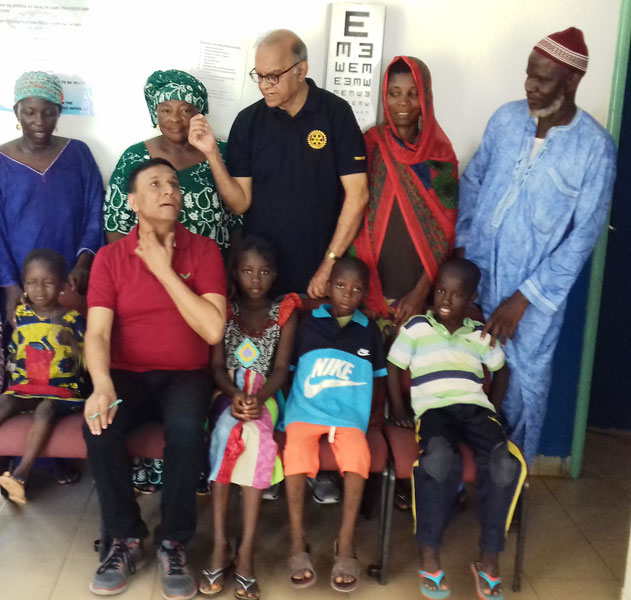 Ophthalmologists M V Ravikumar (standing third from left) and K V Ravishankar (seated) with the Gambian children.