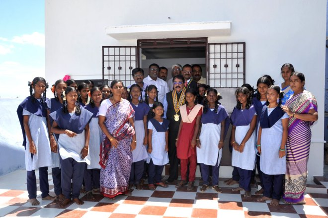 IPDG K Vijayakumar (centre), IPP G Vasu, PDG T A Nellainayakgam and DGN S Sheik Saleem with students and staff of the Ramaseshier School after inaugurating the toilet block.