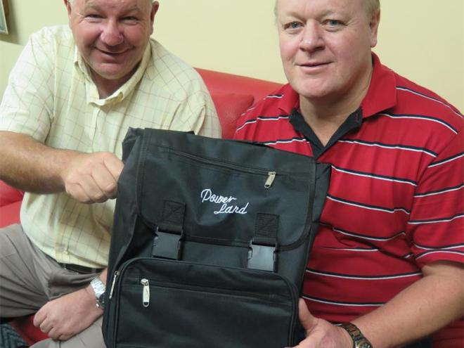 Seen here are Rotary Club Boksburg's president-elect Derek Fox (left) and current president Noel Wauchope who are hoping to buy many of these schools bags with funds raised from Rotary's Christmas Market and Carols by Candlelight.