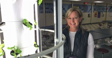 Onalaska garden director Jodie Visker is pictured next to the middle school's aeroponic garden towers which are used to grow lettuce greens and herbs. Photo: Tobias Mann