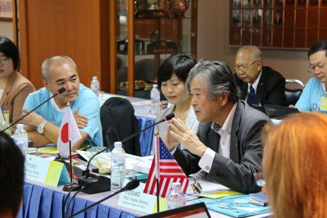 Yoshio Shimizu, Chairman of the Japanese magazine, Rotary-no-Tomo, addresses the meet. Also seen: the magazine's Editor Kyoko Nozaki.