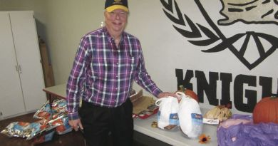 Rotarian Phil Sherwood stands next to turkeys that will be donated to needy families in Clyde W Needham Elementary School's cafeteria. Photo: John Bays/News-Sentinel