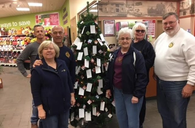 Victor-Farmington Rotarians set up the 2017 Rotary Giving Tree at Tops Friendly Markets in Farmington, one of its many community service projects. Photo: Dave Luitweiler
