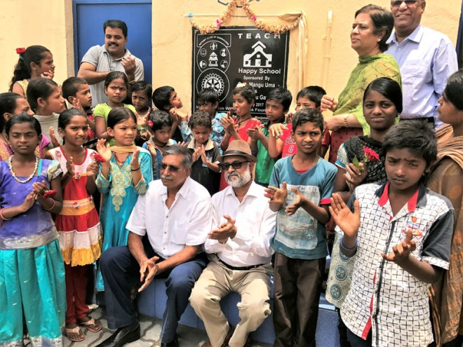 F R Singhvi, MD of Sansera Engineering and a generous donor (left), and Ranga Rao along with the children in a renovated school.