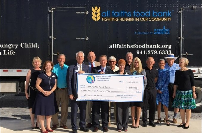 Rotarians present a cheque for $40,000 to Sandra Frank, CEO of All Faiths Food Bank.