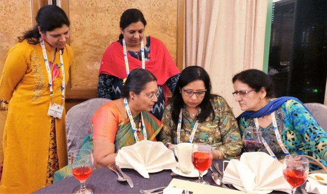 Mala Basker (seated left) in discussion with the spouses.