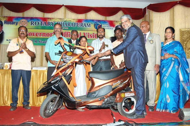 DG P M Sivashankaran handing over the keys to Maheswari in the presence of PDG George Sundararaj and spouse Priscilla and club members.